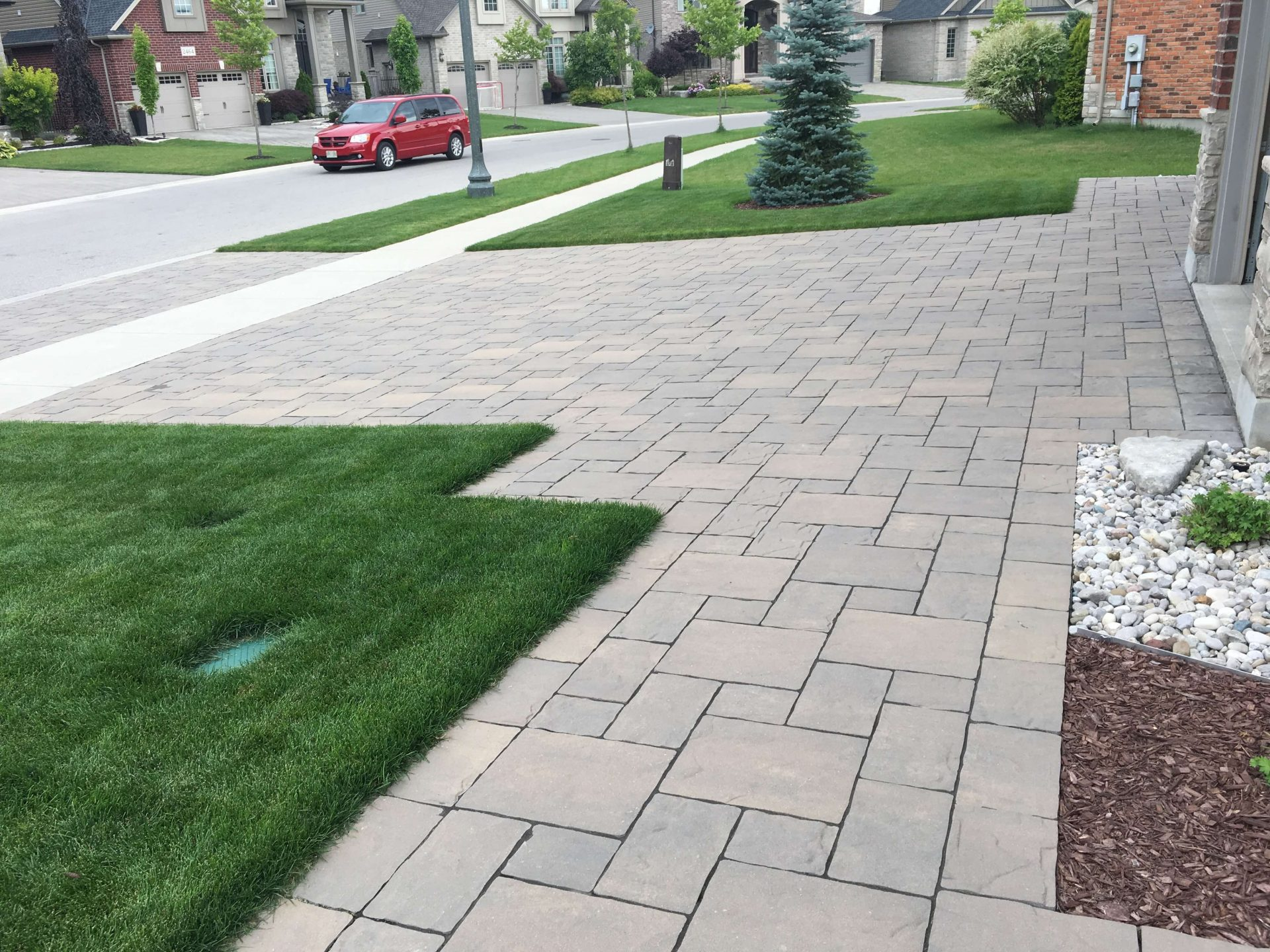 Cobble stone Drive way and fresh green grass