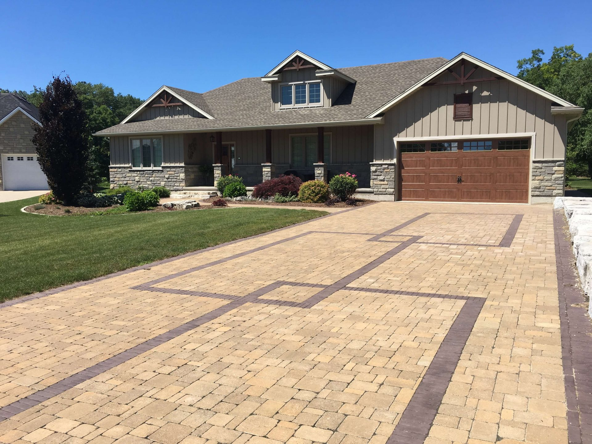 Large drive way view of bungalow home