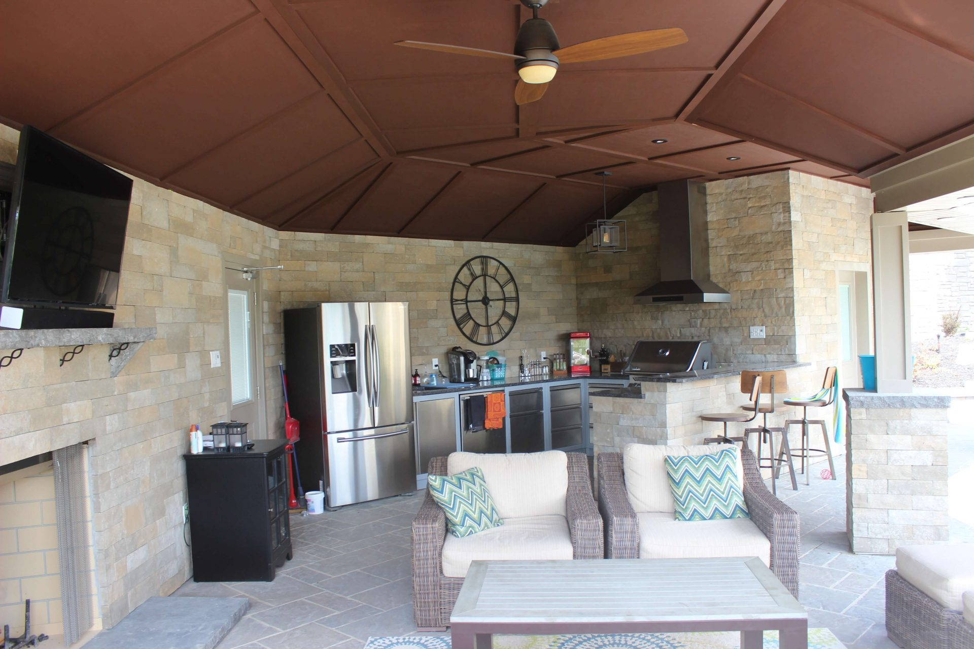 Inside pool house lounge area and kitchen
