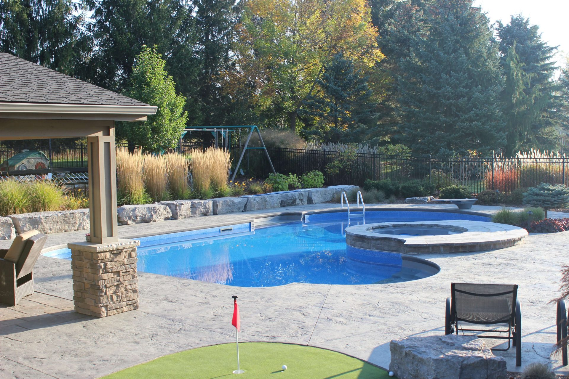 Hot tub for two built into underground pool of backyard