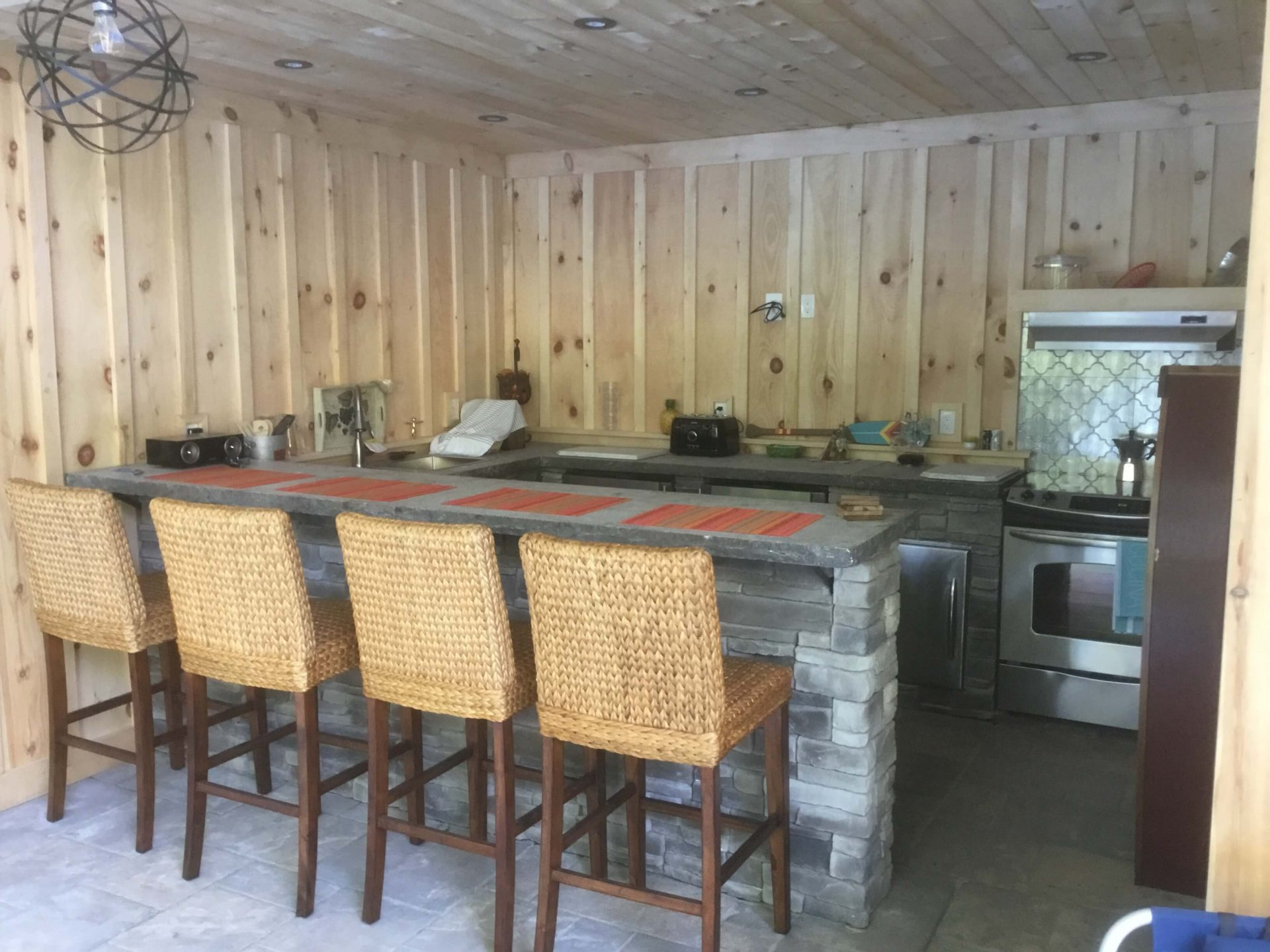 Inside pool house featuring kitchen and bar top table