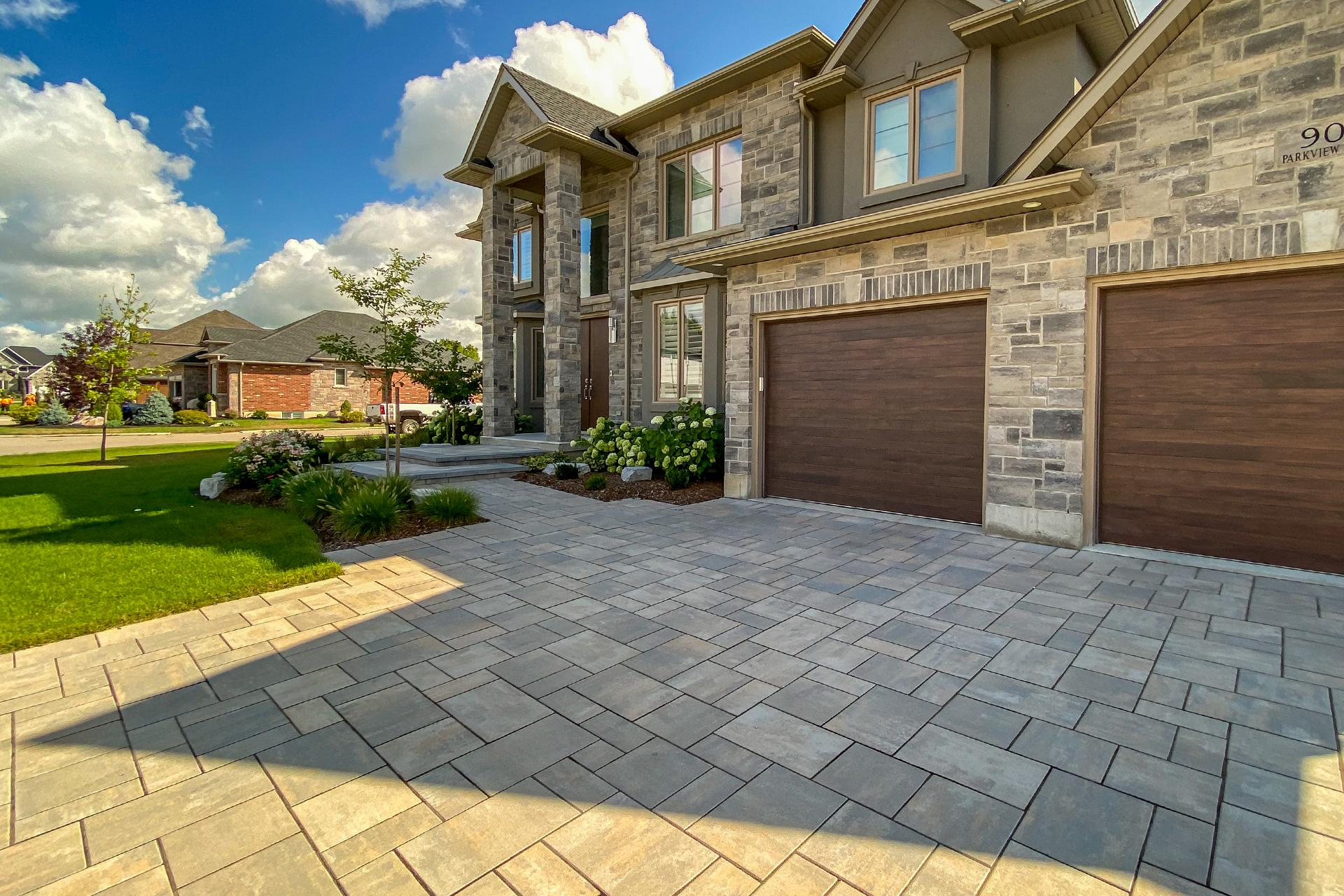 Image of front of house with well made driveway