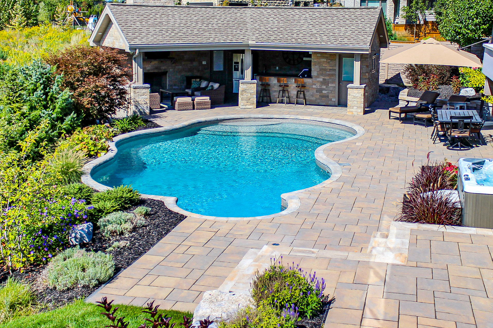 Image of a beautiful backyard pool and outdoor living space
