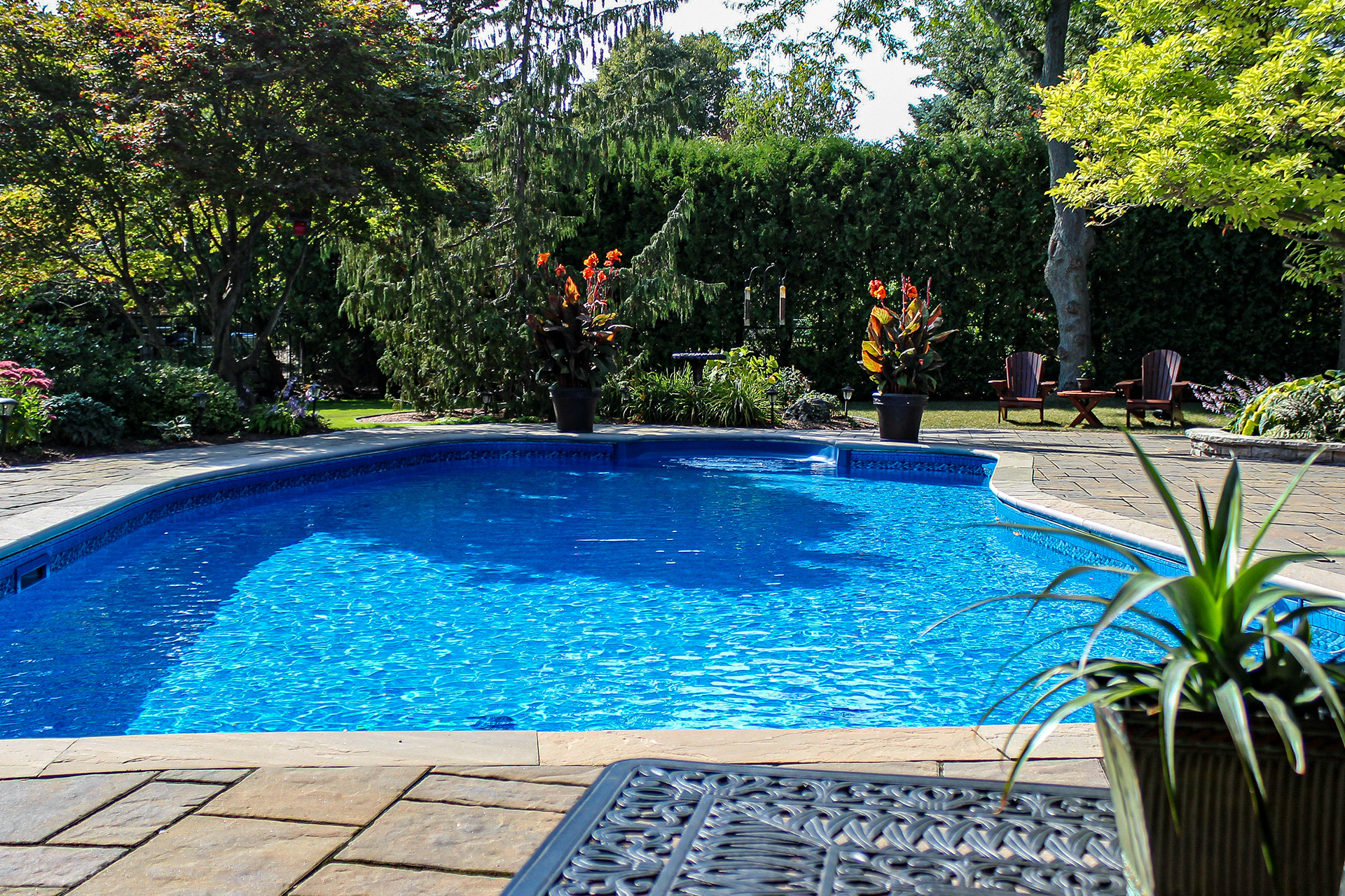 Image of a backyard pool that is blue.